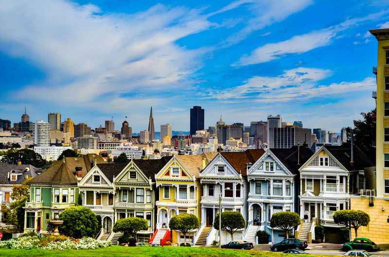 Painted Ladies in the city California Frisco Painted Ladies San Francisco San Francisco Architecture Building Exterior Built Structure City Cityscape Cloud - Sky Day No People Outdoors Painted Ladies Residential Building Sky Skyscraper Travel Destinations Tree Urban Skyline Victorian Architecture Stories From The City California Dreamin Stories From The City EyeEmNewHere