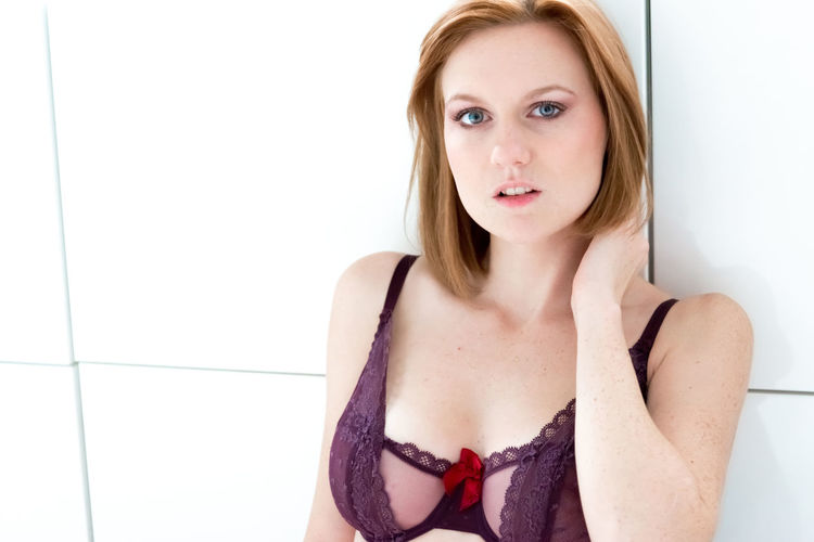 Portrait Of Beautiful Young Woman Wearing Bra