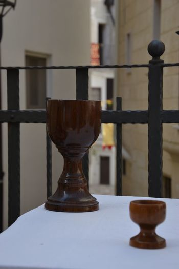 Focus On Foreground No People Close-up Table Indoors  Architecture Still Life Built Structure Day Railing Window Candlestick Holder Religion Building Glass - Material Candle Shape Seat Metal