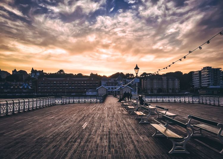 Penarth Pier at sunset Dramatic Sky Perspective Pier Sunset_collection Benches Boardwalk Built Structure Cloud - Sky Day No People Outdoors Seaside Sky Sunset Travel Destinations Water