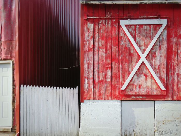 C&o Canal The EyeEm Collection Hinge Red And White Crisscross Faded Paint Geometric Shape EyeEm Selects Corrugated Iron Red Wood - Material Door Façade Entrance Close-up Architecture Building Exterior Closed Door Peeling Off Weathered Deterioration Peeled Closed