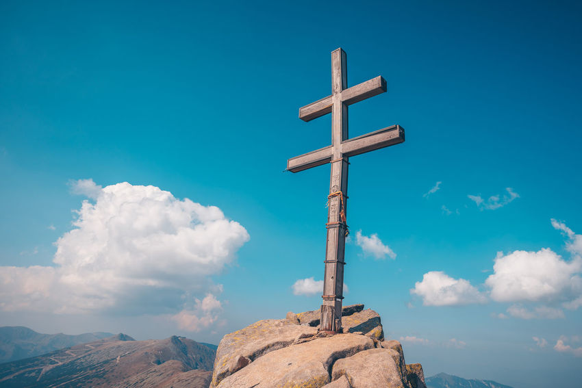 Dumbier peak. Double cross on a highest point of Low Tatras Cross Double Cross Dumbier Beauty In Nature Belief Blue Cloud - Sky Cross Cross Shape Day Mountain Peak Nature No People Outdoors Peak Religion Rock Rock - Object Scenics - Nature Sky Solid Spirituality Symbol Tranquil Scene Tranquility