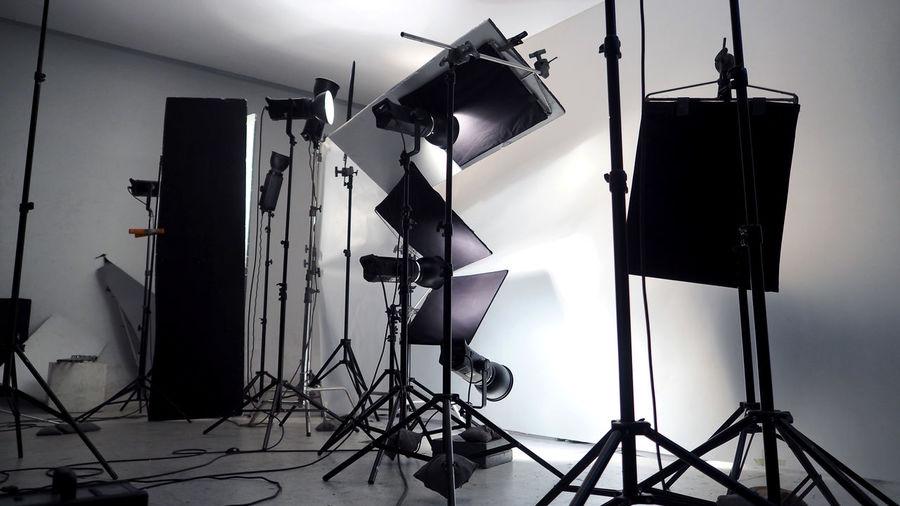 Tilt image of electric lamp against sky