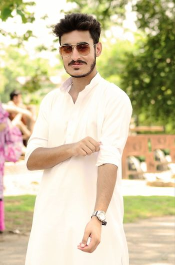 Young man wearing kurta on field