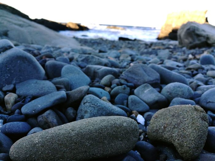 Sea Beach Sea Shore Water Stone - Object Tranquil Scene Tranquility Vacations Pebble Rock - Object Nature Scenics Ocean Beauty In Nature Calm Surface Level Day Pebble Beach Focus On Foreground Non-urban Scene