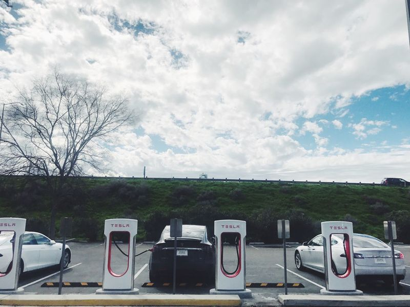 Supercharging along I-5: Buttonwillow // Cloud - Sky Sky No People Nature Fossil Fuel Land Vehicle Gas Station Outdoors Day Technology Fuel Pump Supercharger Tesla Tesla Model X The Future Is Electric