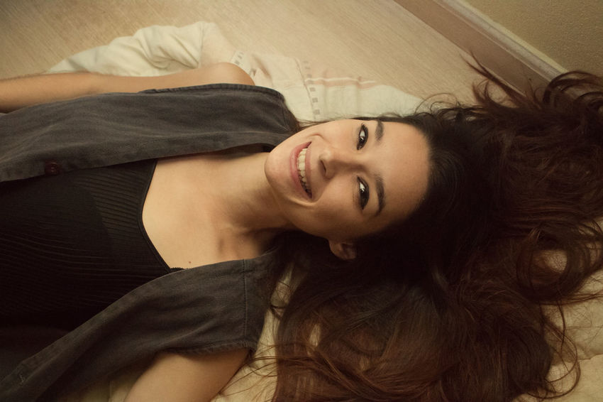 Adult Beautiful Woman Beauty Bed Bedroom Cheerful Close-up Comfortable Day Happiness Home Interior Indoors  Long Hair Looking At Camera Lying Down One Person One Woman Only People Portrait Real People Relaxation Smiling Young Adult Young Women The Portraitist - 2017 EyeEm Awards BYOPaper!