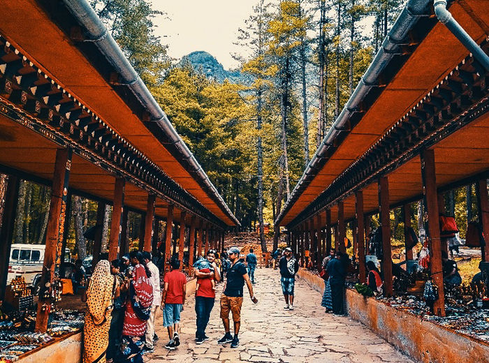 The market place Of Bhutan. Uphill Uphill Road UphillVillage EyeEm Nature Lover Eyeemphotography Symmetry_seekers Vintage Photo Chilly Marketplace Tranquility Travel Market In Bhutan Tree Men Women City Roof Architecture Sky Built Structure