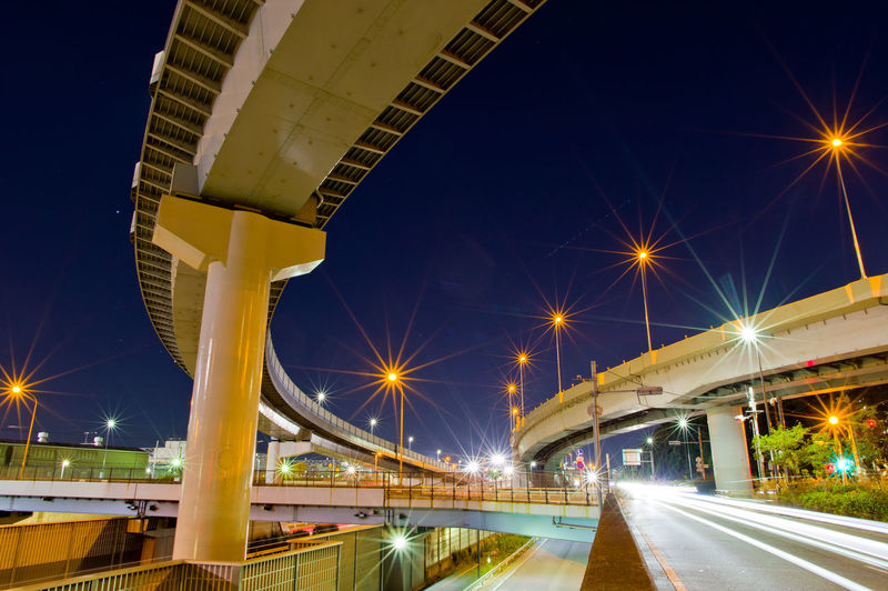 Illuminated Architecture Night Built Structure Motion City Road Long Exposure Connection Street Light Bridge - Man Made Structure Transportation Street Building Exterior Lighting Equipment Speed Blurred Motion Engineering Light Trail Modern Outdoors Multiple Lane Highway Overpass Japan Tokyo Night