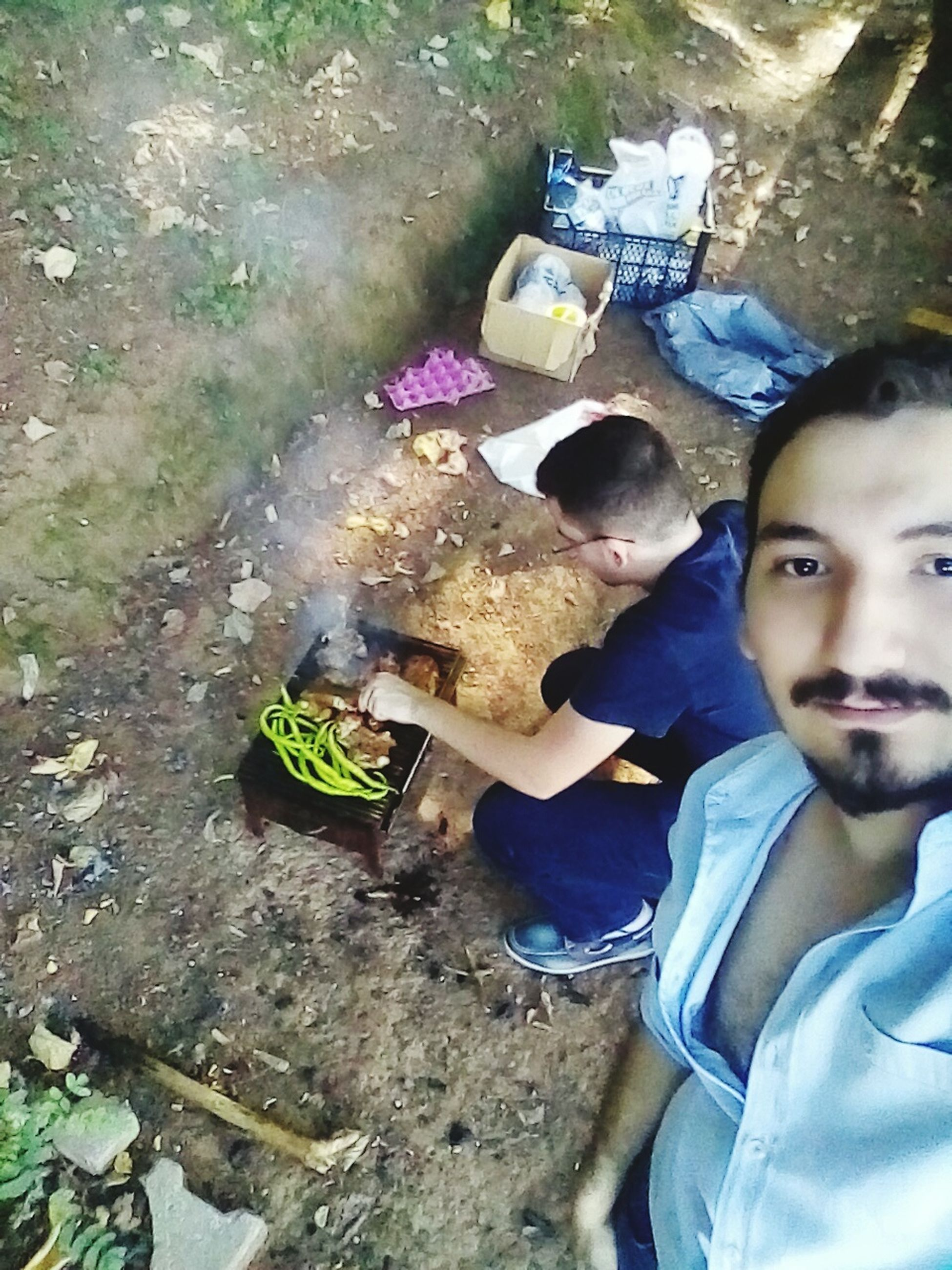 lifestyles, leisure activity, high angle view, childhood, person, casual clothing, boys, sitting, togetherness, day, elementary age, outdoors, smiling, looking at camera, relaxation, girls, happiness, portrait