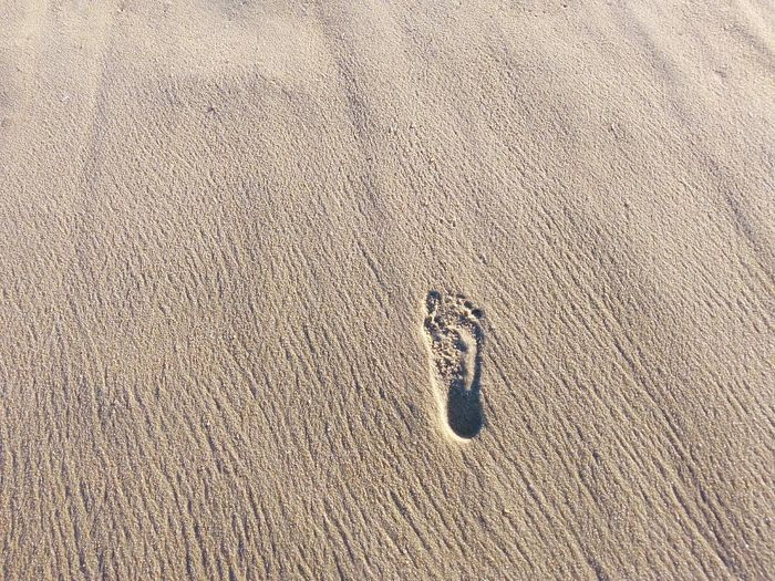 A footstep on beach sand