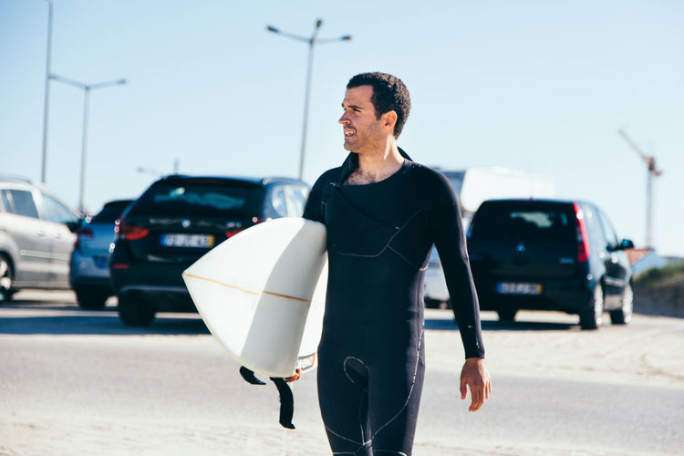 Portrait Of Surfer In Carpark