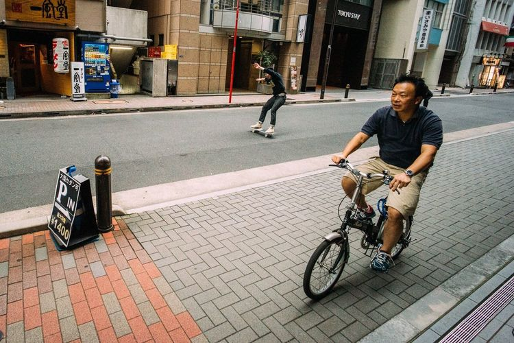 Power sliding the streets of Ginza with Trevor Andrew (and friend on bicycle) Troubleandrew Tokyo Japan