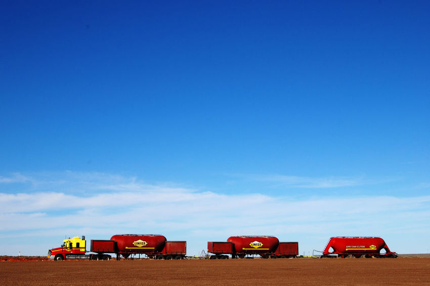 Road train in South Australia Australia Blue Copy Space Day Driving Emptiness Freight Transportation Land Vehicle Mode Of Transport Multi Colored Nature No People Outback Outdoor Photography Outdoors Red Road Road Trip Sky Sky And Clouds Transportation Transportation Travelling Truck Truckerslife