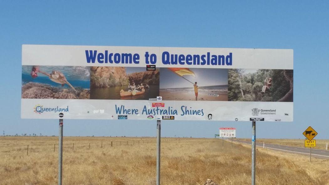51 days driving around Australia - Day 38 Queensland Border Communication Direction Guidance Road Sign Signboard Text Travel Australia Travel Destinations