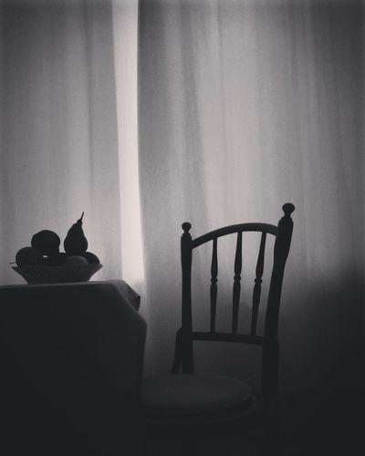 Silhouette man standing in kitchen