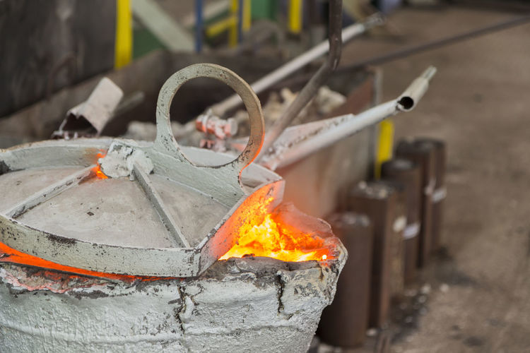 Burning Casting Casting Close-up Fire Fire - Natural Phenomenon Flame Focus On Foreground Foundry Glowing Heat - Temperature Heating Iron - Metal Laddle Ladle Metal Metal Industry Motion Nature No People Orange Color Outdoors Preheating Temperature