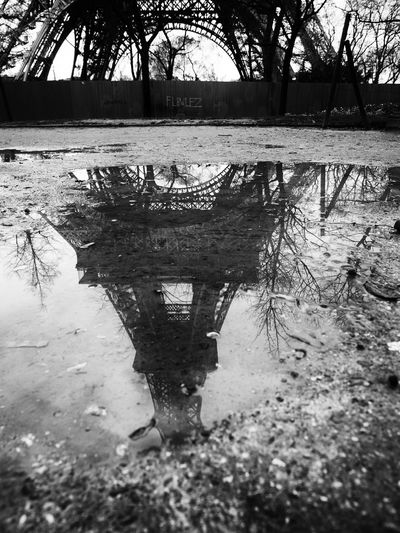 Montmartre, Paris - January 7, 2018: In Montmartre, among the most special places, there is certainly Place du Tertre. It 'a mix of street artists, portrait artists, painters, caricaturists. Beautiful Black And White Eiffel Eiffel_tower  Europe France Landmark Metal Monument Mud Paris Puddle Puddle Of Water Puddle Reflections Rain In Paris Raindrops Reflection Reflections Romantic Romantic Paris Scenic Silhouette Steel Tower Vintage Water