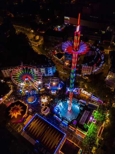 Amusement Park Amusement Park Ride Architecture Arts Culture And Entertainment Building Exterior Carousel Celebration Christmas Decoration Ferris Wheel High Angle View Illuminated Multi Colored Night No People Outdoors