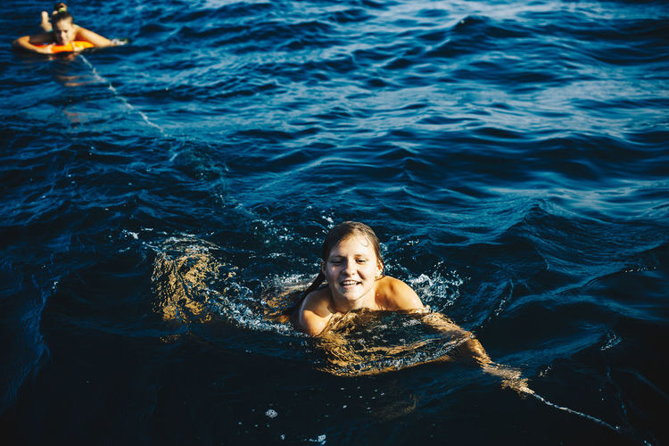 Portrait of young woman in sea
