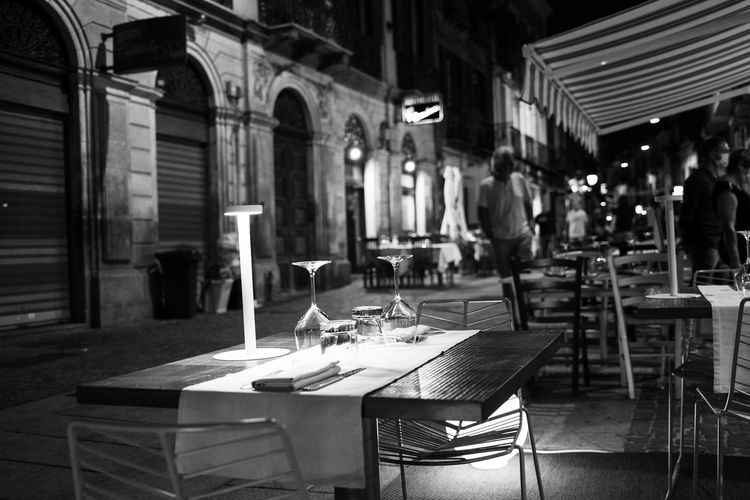 Chairs and tables in restaurant at night