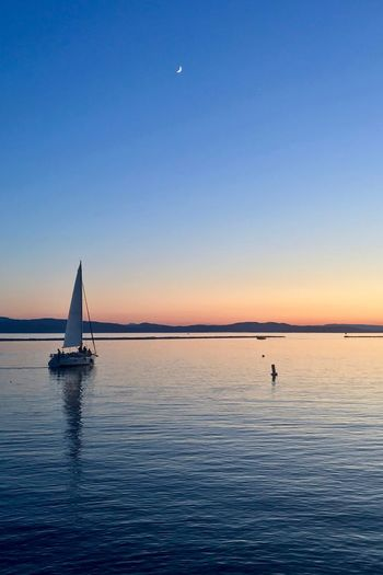 Sailing into the sunset... Moon Calm Waters Lake Burlington, Vermont Vermont Lake Champlain EyeEm Selects Water Sky Sunset Beauty In Nature Scenics - Nature Nautical Vessel Sailboat Sailing Blue Clear Sky Outdoors Mode Of Transportation Transportation Tranquility
