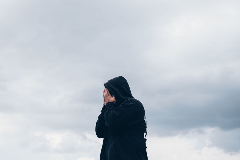 Boy in black hoodie with hands covering his face Beauty In Nature Cloud - Sky Conceptual Copy Space Emotion EyeEmNewHere Hidden Hooded Shirt Identity Leisure Activity Lifestyles Low Angle View Men Minimal Nature One Person Outdoors People Portrait Real People Sky Standing TCPM Teenager Unknown Break The Mold The Portraitist - 2017 EyeEm Awards Live For The Story Place Of Heart Sommergefühle Let's Go. Together. Breathing Space The Week On EyeEm Mix Yourself A Good Time Be. Ready. Rethink Things This Is Masculinity Stories From The City Go Higher Inner Power Visual Creativity This Is My Skin The Portraitist - 2018 EyeEm Awards The Great Outdoors - 2018 EyeEm Awards The Creative - 2018 EyeEm Awards The Fashion Photographer - 2018 EyeEm Awards 10 The Photojournalist - 2018 EyeEm Awards Summer Road Tripping The Traveler - 2018 EyeEm Awards The Troublemakers Love Is Love The Street Photographer - 2018 EyeEm Awards #urbanana: The Urban Playground