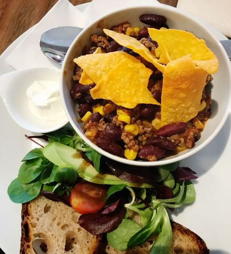 Small chili con carne with salad Real Food Portion Nobody Chili Con Carne Food And Drink Food Ready-to-eat Freshness Healthy Eating Bowl Serving Size Plate Table Meal High Angle View Directly Above No People Close-up