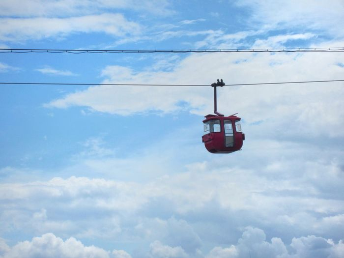 Empty Hanging Cable Car Overhead Cable Car Sky Hanging Cable Outdoors No People Emptiness Red On Blue Day Low Angle View Cloud - Sky