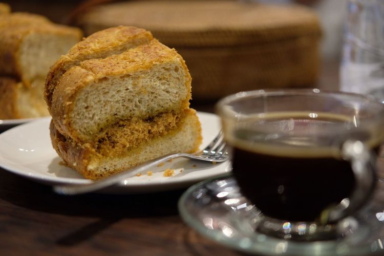 Close-Up Of Bread And Black Coffee On Table
