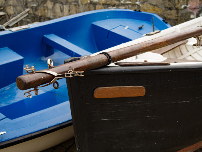 Close-up of old boat against blue sky