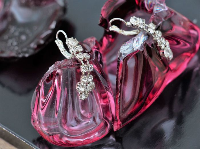 earrings, on a crushed perfume bottle Earrings Pink Shine Black Bottle Crushed Fashion Earrings Fashion Model Fashion Photography Femininity Gems Gemstone  Glass Jewelery Jewellery Pair Perfume Piece Precious Gem Sharp Silver  Sliver Earings Wood - Material