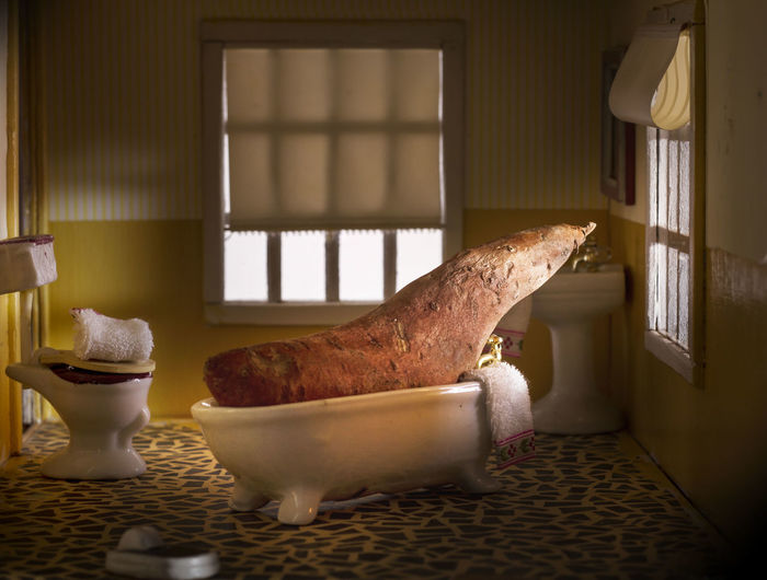 Sweet Potato On Bathtub In Dollhouse