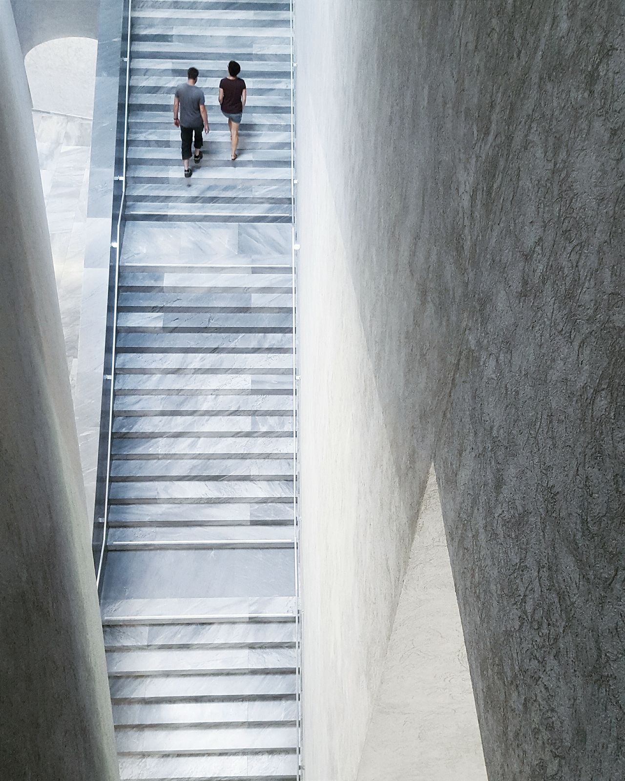High angle view of couple on staircase at kunstmuseum basel