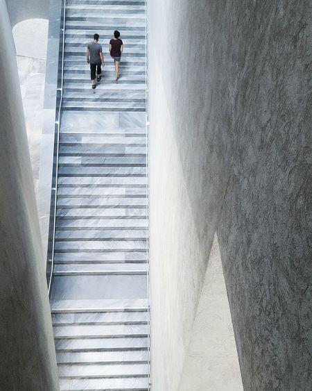 High angle view of couple on staircase at kunstmuseum basel