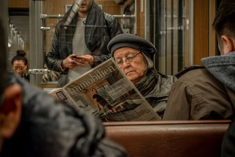 Immobilien. You just turn the page and move on. That's newspaper. Newspaper Reading Train Metro Cap Immobilien Portrait Travel People Germany Beautiful Woman Munich Old Woman Ubahn Ubahn München Portrait Photography Portrait Of A Woman Portraits Of EyeEm Politics And Government Warm Clothing Headshot Women Sitting Close-up Passenger Train Knit Hat Winter Coat EyeEmNewHere The Modern Professional Capture Tomorrow Human Connection Moments Of Happiness It's About The Journey