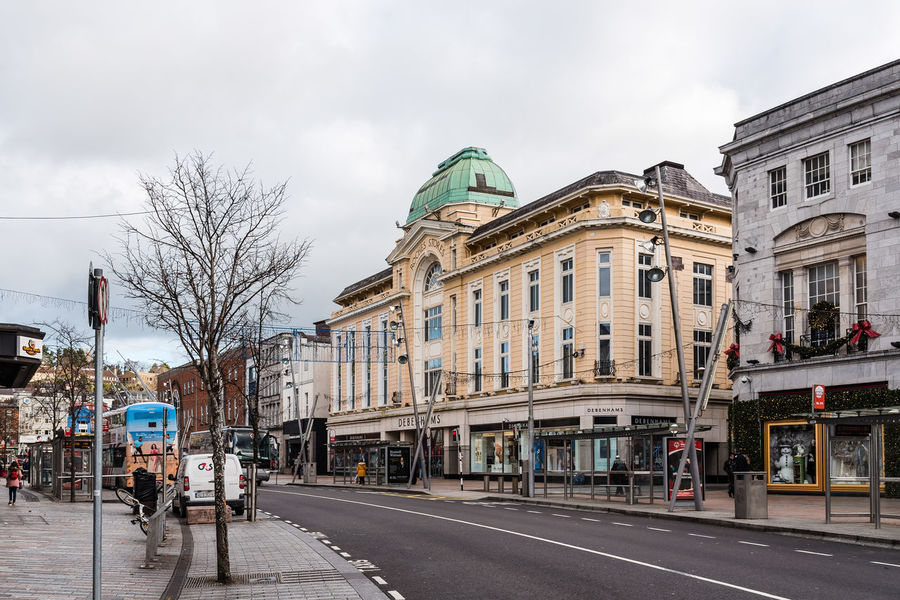 St Patrick Street in City Center of Cork Architecture City Cityscape Commercial Street Shopping Travel Architecture Building Exterior Built Structure City Cloud - Sky Commercial County Day Irish Land Vehicle One Person Outdoors People Politics And Government Real People Road Shop Sky St Patrick Store Street Transportation Urban