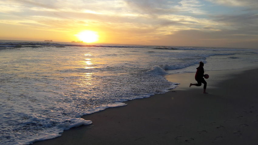 Sunset Beach Sea Sun Sand Reflection One Person Sunlight Sky Beauty In Nature Horizon Over Water Water Scenics Outdoors Nature Summer Travel Destinations Blaauwberg Beach Cape Town South Africa Silhouette