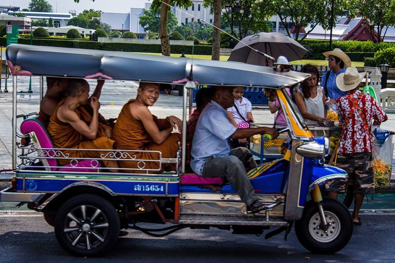 A cool Street Photography moment in Bangkok - Thailand . It could have been just another Monk  in TukTuk picture, but I got spotted and given a beautiful Smile . It is indeed the Land Of Smiles ! Spotted In Thailand Hello World Travel Photography Street Transportation Ride
