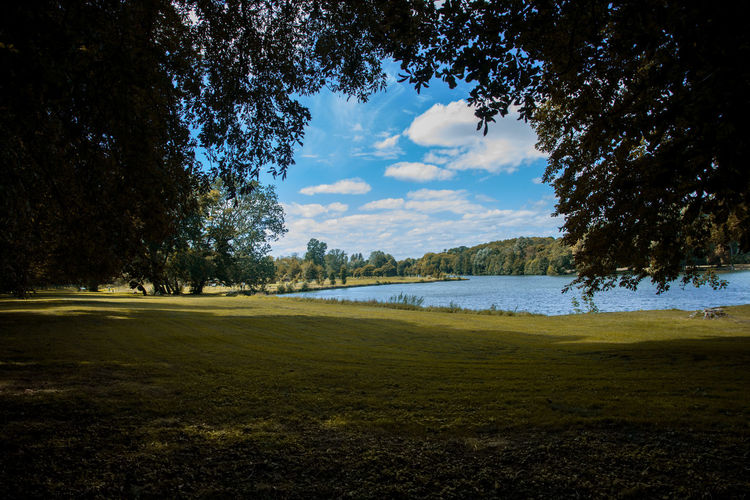 Beauty In Nature Day Field Golf Golf Course Grass Green - Golf Course Green Color Growth Lake Landscape Nature No People Outdoors Scenics Sky Tranquil Scene Tranquility Tree Water