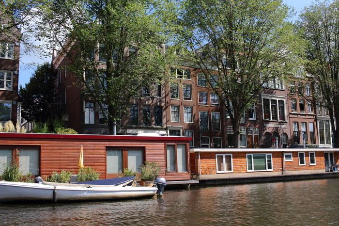 Amsterdam EyeEm City Architecture Building Exterior Built Structure Day Eyeem Amsterdam Houseboats In Amsterdam Nautical Vessel No People Outdoors Residential Building Travel Destinations Tree Water