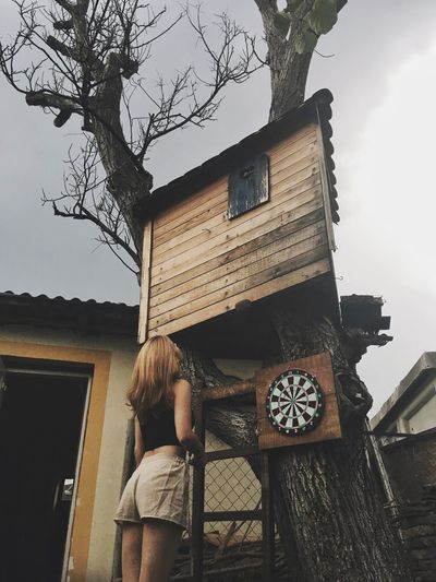 Real People Built Structure Building Exterior Architecture Childhood House One Person Tree Lifestyles Outdoors Wood - Material Leisure Activity Day Boys Low Angle View Standing Sky People