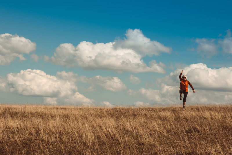 Beauty In Nature Casual Clothing Cloud - Sky Day Field Full Length Grass Healthy Lifestyle Horizon Over Land Landscape Leisure Activity Lifestyles Nature One Person One Woman Only Outdoors Real People Rural Scene Scenics Sky Standing Summer Tranquil Scene Tranquility Women