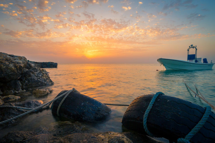 Beach Beauty In Nature Day Horizon Over Water Moored Nature Nautical Vessel No People Outdoors Rock - Object Scenics Sea Sky Sunset Tranquil Scene Tranquility Transportation Water