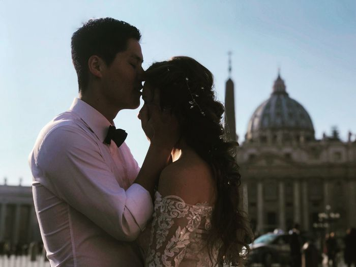 Young couple kissing in city