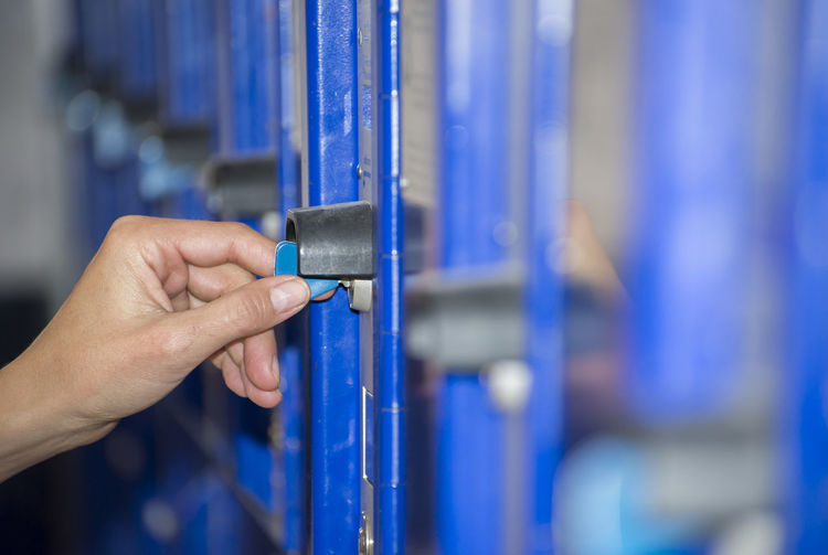 Cropped Hand Of Person Holding Key In Locker