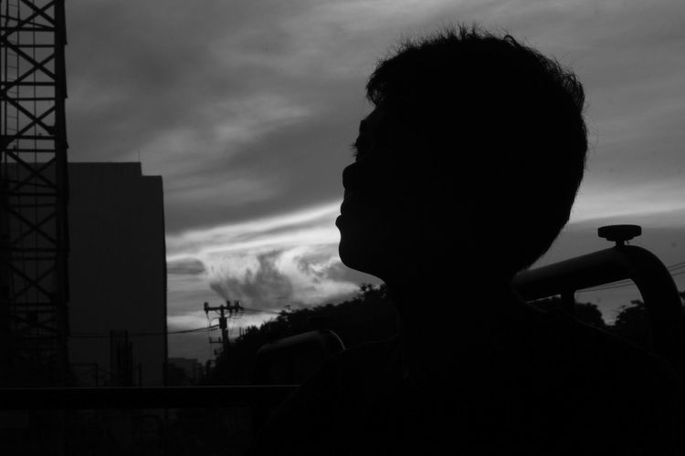 Portrait of silhouette man against sky during sunset