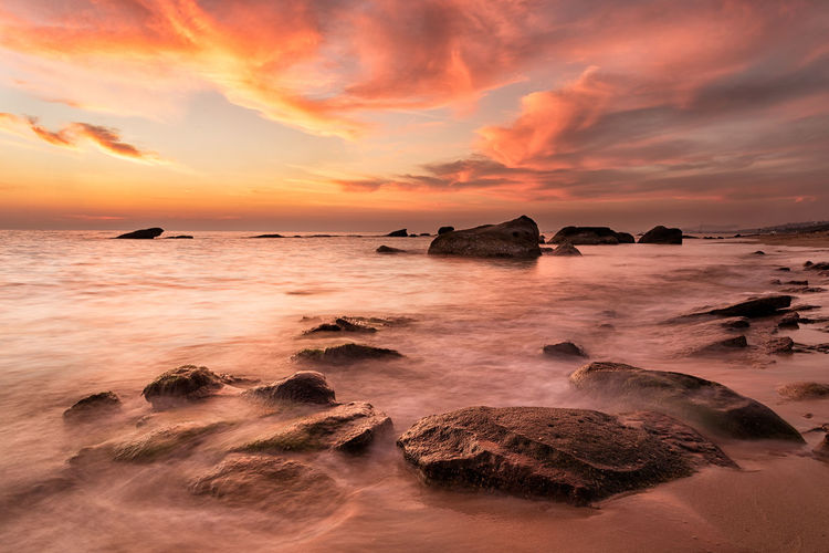 More heaven and more sea Motion Blur Orange Orange Sky Vietnam Beach Beauty In Nature Cloud - Sky Horizon Over Water Long Exposure Nature No People Orange Color Outdoors Phu Quoc Rock - Object Scenics Sea Shore Sky Sunset Water Wave