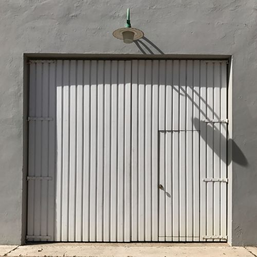 El Paseo. Architecture Built Structure No People Day Building Exterior Outdoors Door Shadow Urban Geometry Architecture_collection Architectural Detail EyeEm Best Shots Minimalism Sunlight Entrance The Street Photographer - 2017 EyeEm Awards The Architect - 2017 EyeEm Awards