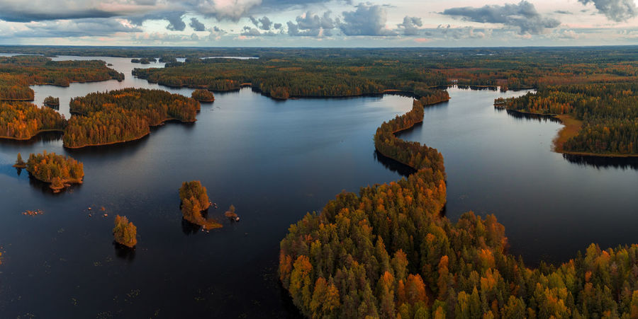Panorama aerial view from Liesjärvi National Park on an autumn afternoon with sun starting to go down, Finland Autumn colors Finland Liesjärvi Autumn🍁🍁🍁 Beauty In Nature Cloud - Sky Day High Angle View Lake Nature No People Non-urban Scene Outdoors Reflection Scenics - Nature Sky Tranquil Scene Tranquility Tree Water First Eyeem Photo